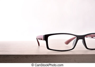 Eyewear on wood table and white background front close up