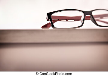 Eyewear on wood table and white background front low angle