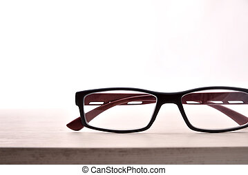 Eyewear on wood table and white background front view detail