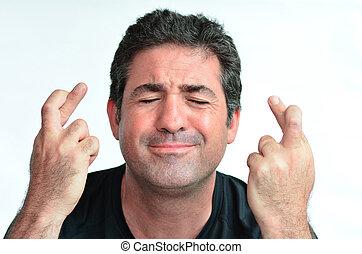 fälliger mann, mit, gekreuzte finger, hoffen, für, glück