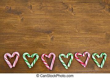 färgrik, godis piskar, uppgjord, in, heart-shapes