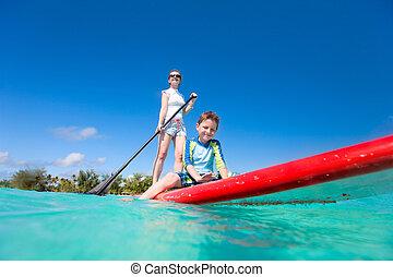 férias tropicais, família