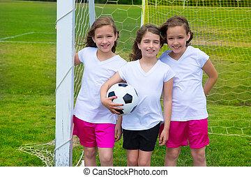 fútbol americano del fútbol, niño, niñas, equipo, en, campo deportivo