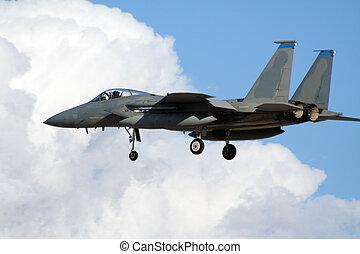 Military airforce F-15 jetplane landing