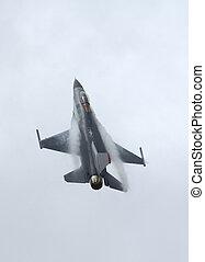 F-16 in airshow - F-16 Fighter Falcon in vertical climb -...