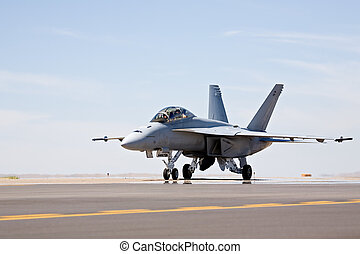 F-18 Hornet military fighter aircraft taxis for takeoff