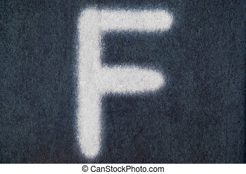 F isolated chalk letter in blackboard background