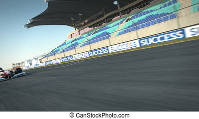 F1 racecar speeding along - Formula One race car speeding...