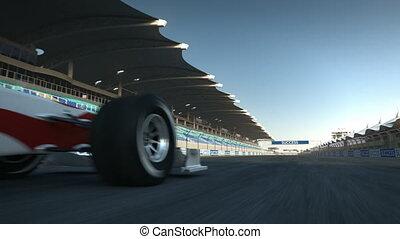 F1 racecar speeding past camera