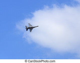 f16 falcon fighter jet flying on blue sky