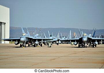 F/A-18 Hornets - USMC F/A-18 Hornets parked outside a...