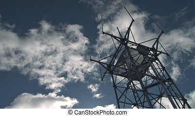 FAA Communication Tower Clouds - Ultra low-angle shot of a...