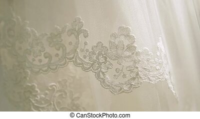 Fabric as backfround. Wedding veil of the bride in white...