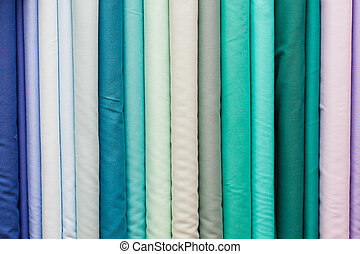 Fabric background - Rolls of colorful fabric as a vibrant...