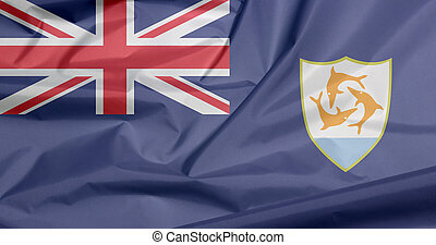 Fabric flag of Anguilla. Crease of Anguilla flag background, Blue Ensign with the British flag and the coat of arms of Anguilla in the fly.