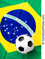 Fabric flag of Brazil and soccer ball