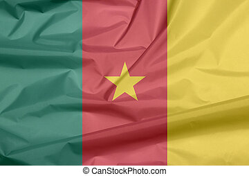 Fabric flag of Cameroon. Crease of Cameroonian flag background, green, red and yellow, with a gold star.