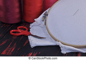 Fabric for embroidery with red threads