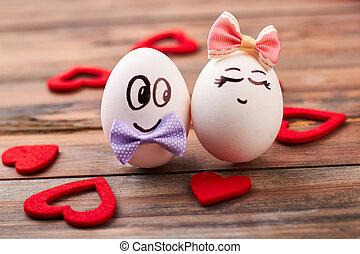 Fabric hearts near love eggs. Egg couple on wooden ...