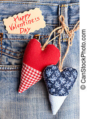 Fabric hearts on jeans pocket.