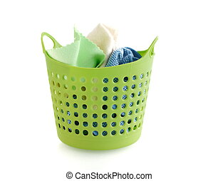 fabric in green plastic basket isolated on white