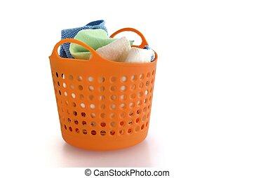 fabric in orange plastic basket isolated on white