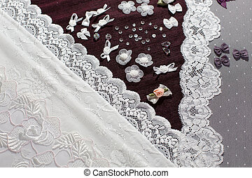 Fabric, lingerie tull and different sewing supplies such as...