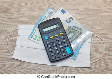 Fabric mask, euros banknotes and calculator