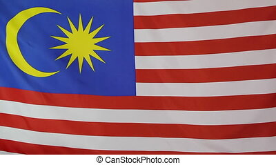 Fabric national flag of Malaysia moving in the wind