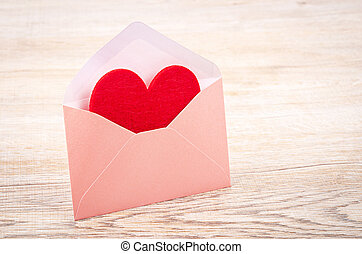 Fabric red heart shape in pink envelupe.