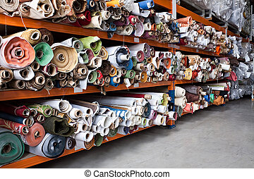 Fabric rolls. - Interior of a industrial warehouse with ...