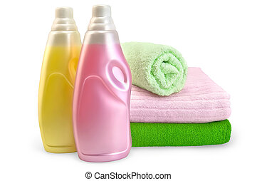 Two bottles of rinser pink and yellow, a stack of towels in isolation on a white background