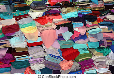 fabric store with rolls of colorful textiles