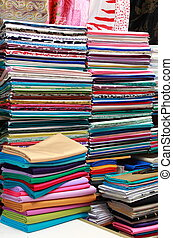 Fabric store with stacks of colorful textiles