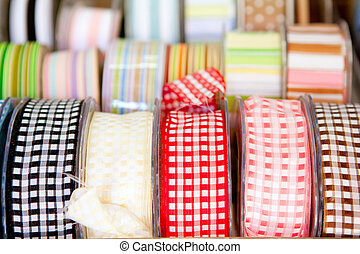 fabric tapes reels in haberdashery of vichy squares