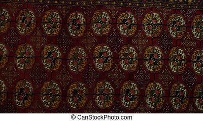 Fabric with Circular Emblems - Handheld, panning, close up...