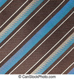 fabric with diagonal various widths blue , black and white stripes as background