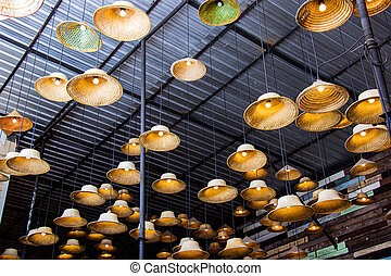 Fabricated lamp from a hat made of local materials bamboo inside restaurant at Amphawa floating market is the tourist most popular in Thailand.