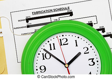 Fabrication schedule with clock - abstract for time frame of...