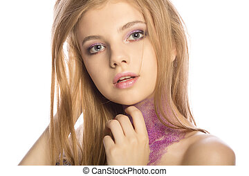 Fabulous blonde model with art makeup posing at studio over a white background
