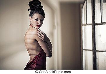 Fabulous brunette beauty wearing evening dress