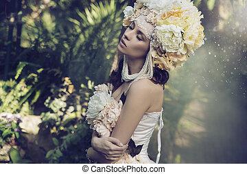 Fabulous brunette woman in the rain forest