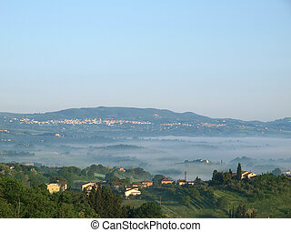 Fabulous landscape of the foggy morning in Tuscany.