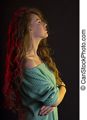 Fabulous model with curly hair in the shadows