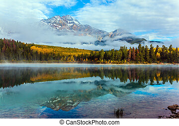 Fabulous reflection. Rocky Mountains, Canada. The Patricia Lake is reflected the Pyramid Mountains. The concept of active, ecological and phototourism