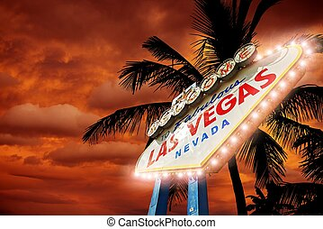 Fabulous Vegas Entrance Sign with Palms and Sunset Sky. Las...