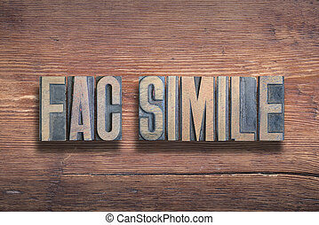 fac simile ancient Latin saying meaning - make alike; origin of the word ?fax?, combined on vintage varnished wooden surface