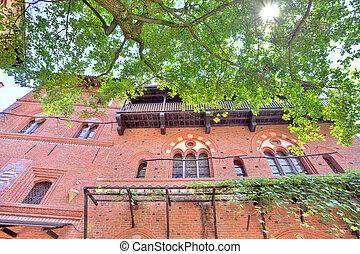 Facade brick wall of Valentino castle in Turin, Italy.