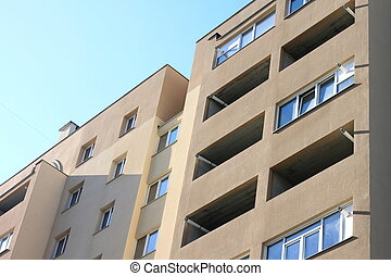 Facade of a beautiful multi-storey modern building with windows and balconies