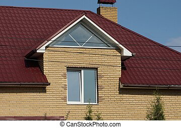 facade of a brown brick private house with a white window